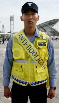 ANTI HOOLIGAN POLICE AWAIT THE ARRIVAL OF FANS OUTSIDE THE JEJU WORLD CUP STADIUM